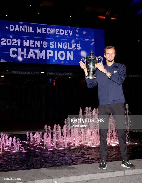 Daniil Medvedev of Russia celebrates with the championship trophy after defeating Novak Djokovic of Serbia to win the Men's Singles final match on...