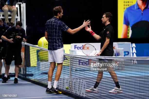 Daniil Medvedev of Russia embraces Dominic Thiem of Austria at the net after winning the singles final during day eight of the Nitto ATP World Tour...