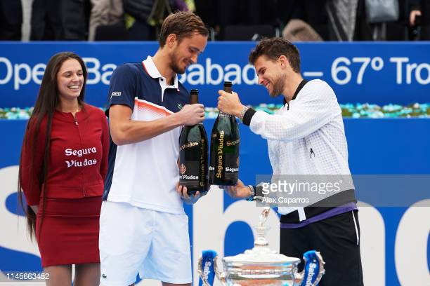 Daniil Medvedev of Russia, finalist, and Dominic Thiem of Austria, winner, celebrate their results after the final match during day seven of the...