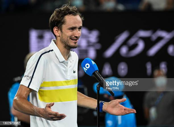 Daniil Medvedev of Russia hits a backhand against Stefanos Tsitsipas of Greece in the second men's singles semi-final during day 12 of the 2021...