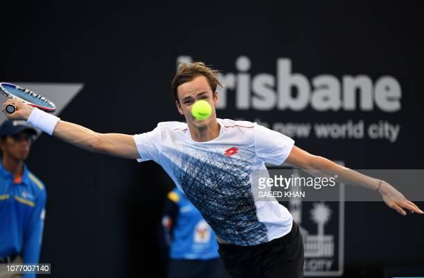 TOPSHOT Daniil Medvedev of Russia hits a return against Milos Raonic of Canada during their men's singles quarterfinal match at the Brisbane...