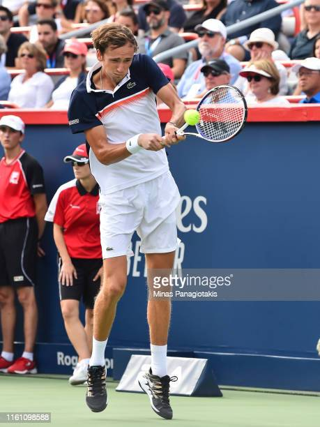 Daniil Medvedev of Russia hits a return against Rafael Nadal of Spain during the mens singles final on day 10 of the Rogers Cup at IGA Stadium on...