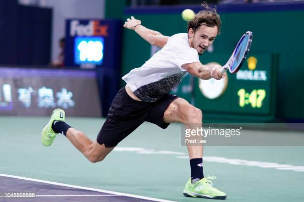 Daniil Medvedev of Russia hits a return against Roger Federer of Switzerland during second round of the 2018 Rolex Shanghai Masters on Day 4 at Qi...
