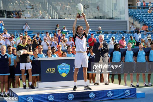 Daniil Medvedev of Russia hoists the Rookwood Cup trophy after winning the Western & Southern Open at Lindner Family Tennis Center on August 18, 2019...