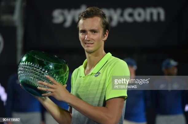 Daniil Medvedev of Russia holds up the trophy after beating Alex De Minaur of Australia in the men's singles final at the Sydney International tennis...