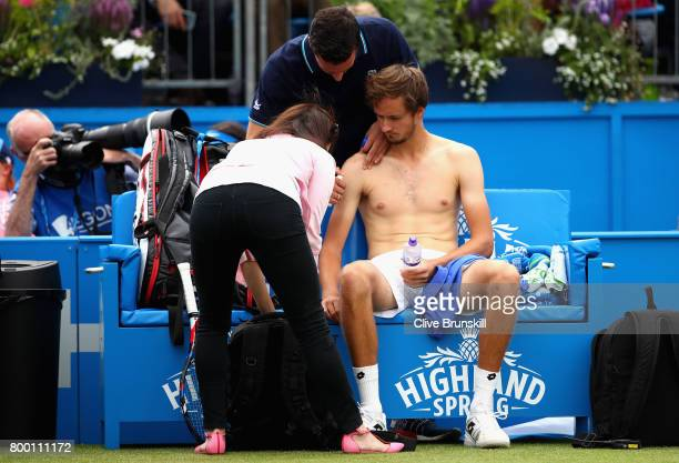 Daniil Medvedev of Russia is given treatment following a shoulder injury in the warm up prior to his mens quarter final match against Grigor Dimitrov...