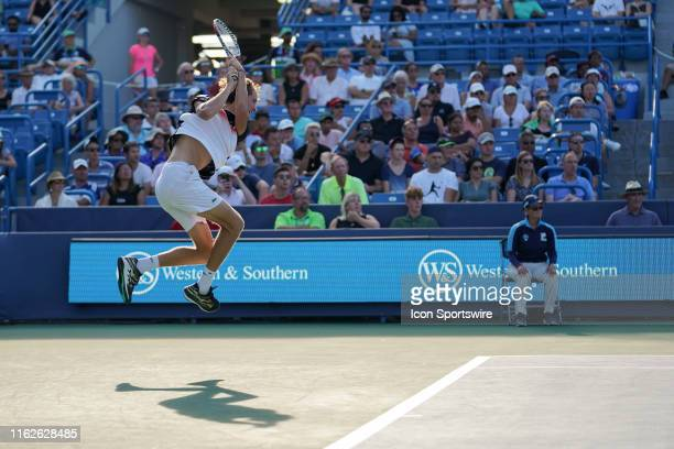 Daniil Medvedev of Russia jumps and hits a two-handed backhand shot during the final match of the Western & Southern Open at Lindner Family Tennis...