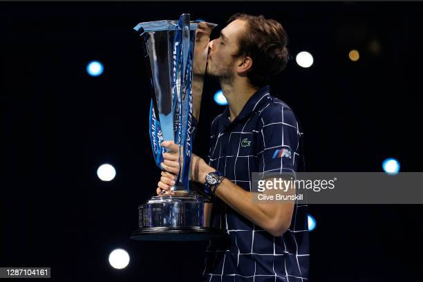 Daniil Medvedev of Russia kisses the trophy after winning his singles final match against Dominic Thiem of Austria during day eight of the Nitto ATP...