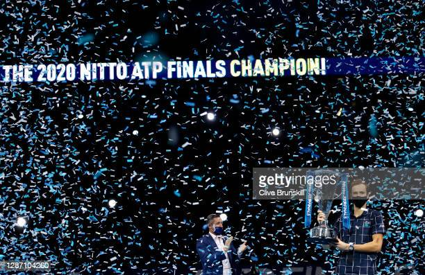 Daniil Medvedev of Russia lifts the trophy after winning his singles final match against Dominic Thiem of Austria during day eight of the Nitto ATP...