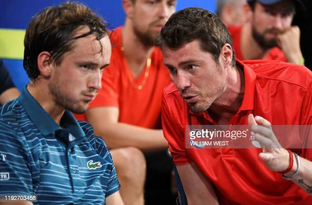 Daniil Medvedev of Russia listens to team captain Marat Safin during his men's singles match against Diego Schwartzman of Argentina at the ATP Cup...
