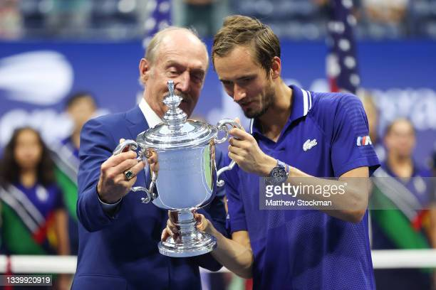 Daniil Medvedev of Russia looks with the championship trophy with former tennis player, Stan Smith, after defeating Novak Djokovic of Serbia to win...