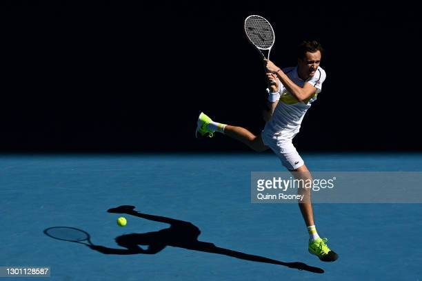 Daniil Medvedev of Russia plays a backhand in his Men's Singles first round match against Vasek Pospisil of Canada during day two of the 2021...