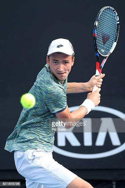 Daniil Medvedev of Russia plays a backhans in his first round match against Ernesto Escobedo of the United States on day two of the 2017 Australian...