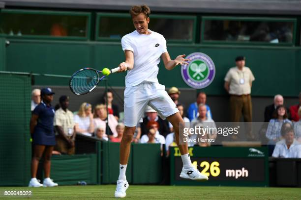 Daniil Medvedev of Russia plays a forehand during the Gentlemen's Singles first round match against Stan Wawrinka of Switzerland on day one of the...