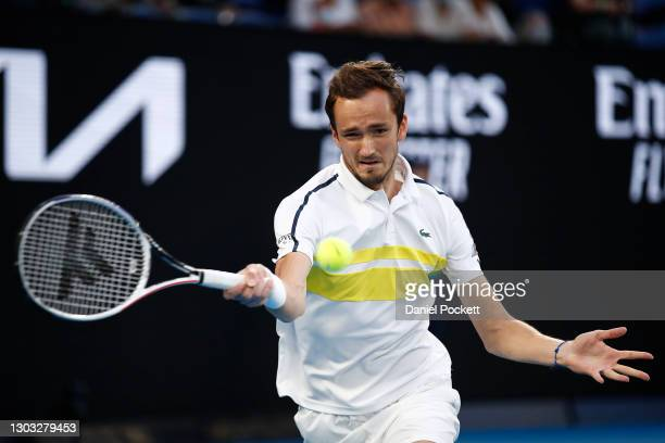 Daniil Medvedev of Russia plays a forehand in his Men's Singles Final match against Novak Djokovic of Serbia during day 14 of the 2021 Australian...