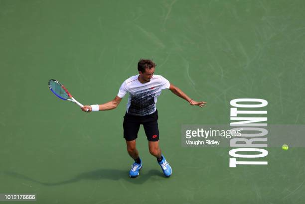 Daniil Medvedev of Russia plays a shot against Jack Sock of the United States during a 1st round match on Day 1 of the Rogers Cup at Aviva Centre on...