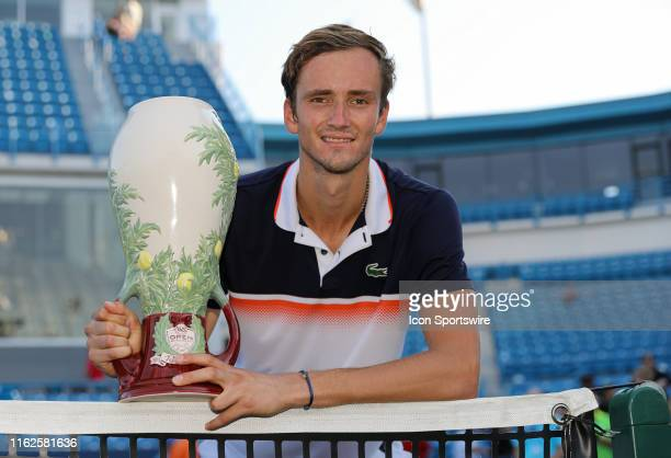 Daniil Medvedev of Russia poses for a photo while holding the Rookwood Cup trophy after winning the Western & Southern Open at Lindner Family Tennis...