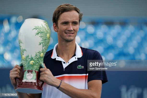 Daniil Medvedev of Russia poses for a photo with the Rookwood Cup trophy after winning the Western & Southern Open at Lindner Family Tennis Center on...