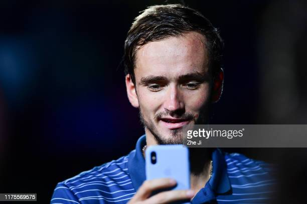 Daniil Medvedev of Russia poses for a photo with the trophy during the Award Ceremony after winning the Men's Singles final match against Alexander...