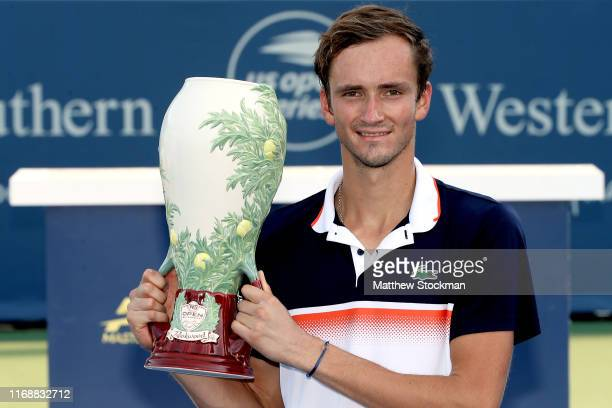 Daniil Medvedev of Russia poses for photographers after defeating David Goffin of Belgium during the men's final of the Western Southern Open at...