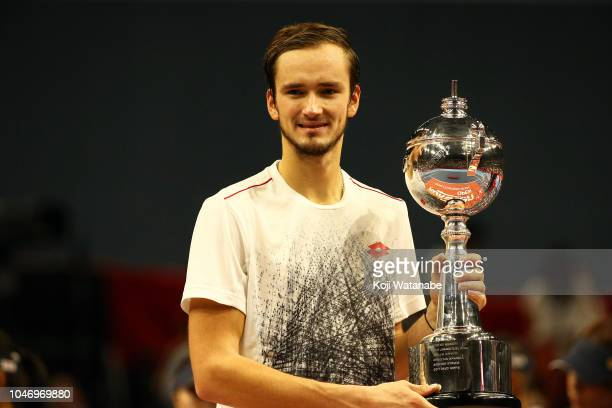 Daniil Medvedev of Russia poses for photographs with the trophy after in the Singles finals round against Kei Nishikori of Japan on day seven of the...