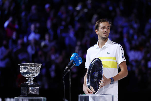 Daniil Medvedev of Russia poses with the runners up plate following his Men's Singles Final match against Novak Djokovic of Serbia during day 14 of...