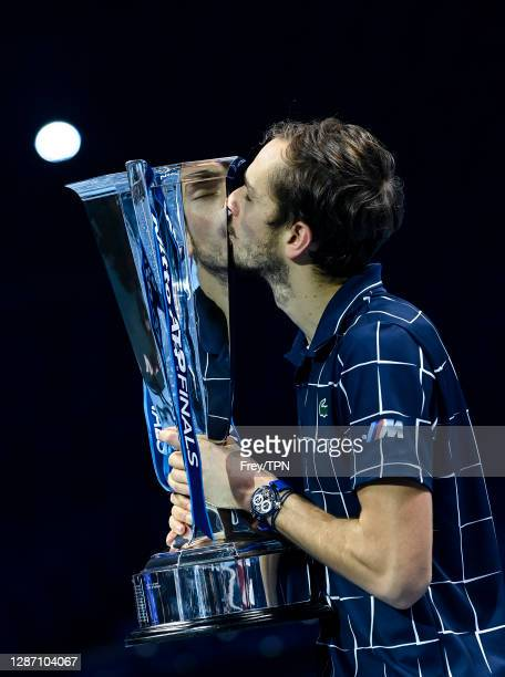 Daniil Medvedev of Russia poses with the trophy after his victory over against Dominic Thiem of Austria in the final on Day 8 of the Nitto ATP World...