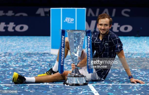 Daniil Medvedev of Russia poses with the trophy after winning his singles final match against Dominic Thiem of Austria during day eight of the Nitto...