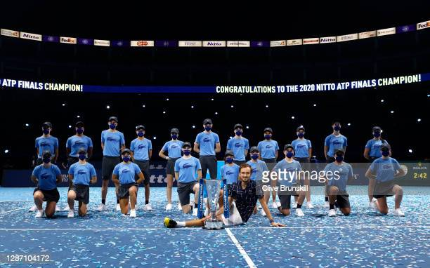 Daniil Medvedev of Russia poses with the trophy and ball kids after winning his singles final match against Dominic Thiem of Austria during day eight...