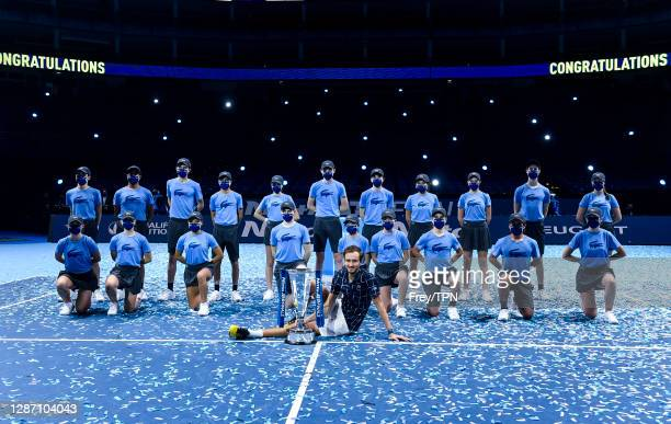 Daniil Medvedev of Russia poses with the trophy and the ball kids after his victory over against Dominic Thiem of Austria in the final on Day 8 of...