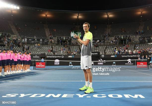 Daniil Medvedev of Russia poses with the winners trophy after his Men's Singles Final match against Alex de Minaur of Australia during day seven of...