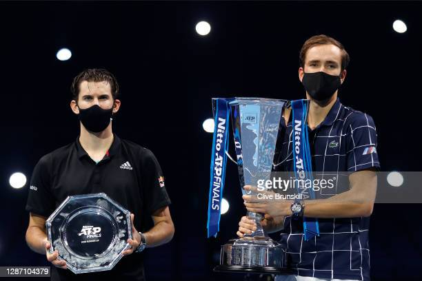 Daniil Medvedev of Russia poses with the winners trophy and Dominic Thiem of Austria poses with runners up plate after their singles final match...
