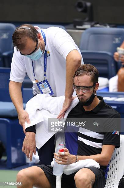 Daniil Medvedev of Russia receives medical attention for his right shoulder during his Men's Singles quarterfinal match against Andrey Rublev of...