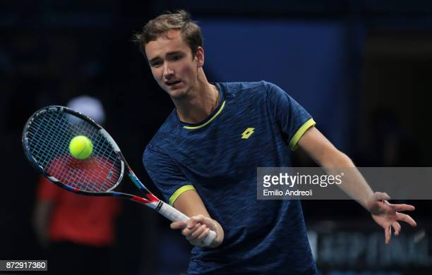 Daniil Medvedev of Russia returns a forehand in his exhibition match against former player Ross Hutchins of England during day 5 of the Next Gen ATP...