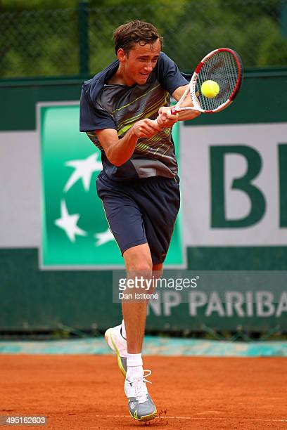 Daniil Medvedev of Russia returns a shot during his boys' singles match against Pedro Martinez Portero of Spain on day eight of the French Open at...