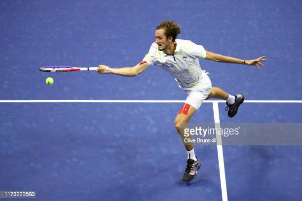 Daniil Medvedev of Russia returns a shot during the fourth set of his Men's Singles final match against Rafael Nadal of Spain on day fourteen of the...