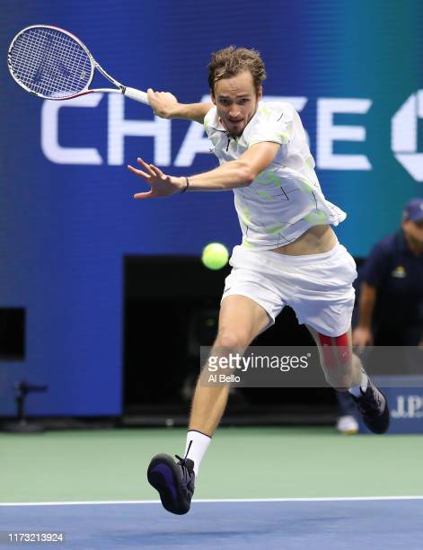 Daniil Medvedev of Russia returns a shot during the third set of his Men's Singles final match against Rafael Nadal of Spain on day fourteen of the...