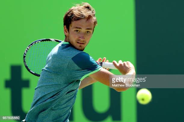 Daniil Medvedev of Russia returns a shot to Alexander Zverev of Germany during the Miami Open Presented by Itau at Crandon Park Tennis Center on...