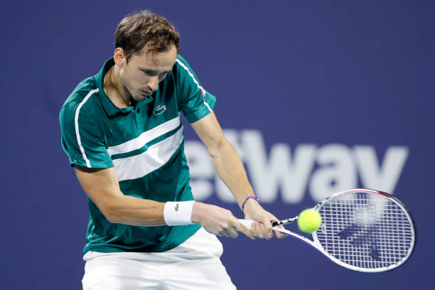 Daniil Medvedev of Russia returns a shot to Roberto Bautista Agut of Spain in their quarterfinal match of the Miami Open at Hard Rock Stadium on...