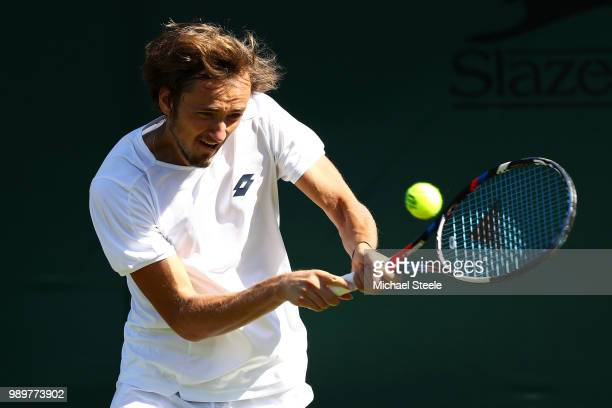 Daniil Medvedev of Russia returns against Borna Coric of Croatia during their Men's Singles first round match on day one of the Wimbledon Lawn Tennis...