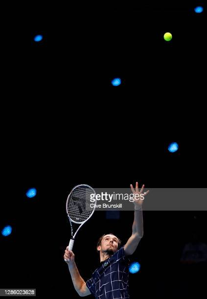 Daniil Medvedev of Russia serves during his singles match against Alexander Zverev of Germany during day two of the Nitto ATP World Tour Finals at...