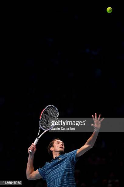 Daniil Medvedev of Russia serves in his singles match against Stefanos Tsitsipas of Greece during Day Two of the Nitto ATP Finals at The O2 Arena on...