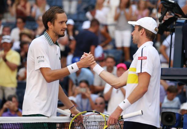 Daniil Medvedev of Russia shakes hand with Botic van de Zandschulp of Netherlands during his Men's Singles quarterfinals match after defeating van de...