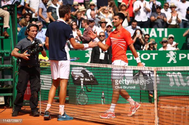 Daniil Medvedev of Russia shakes hands at the net after his three set victory against Novak Djokovic of Serbia in their quarter final match during...