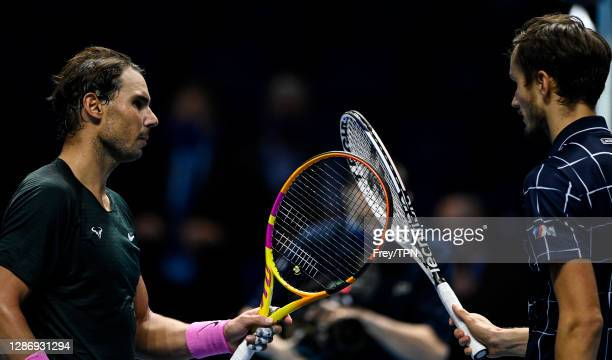 Daniil Medvedev of Russia shakes hands with Rafael Nadal of Spain after beating him on Day 7 of the Nitto ATP World Tour Finals at The O2 Arena on...