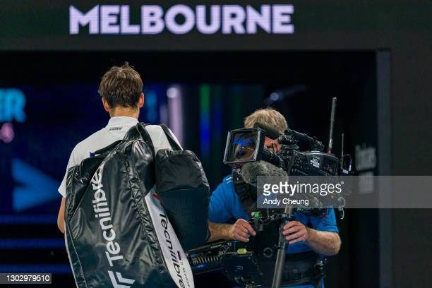 Daniil Medvedev of Russia signs autograph on broadcast camera lens following victory in his Men's Singles Semifinals match against Stefanos Tsitsipas...