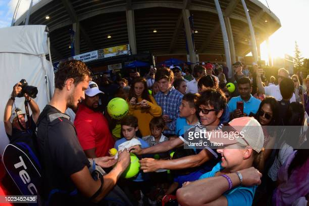Daniil Medvedev of Russia signs autographs for fans after defeating Steve Johnson during the men's singles championship final on day six of the...