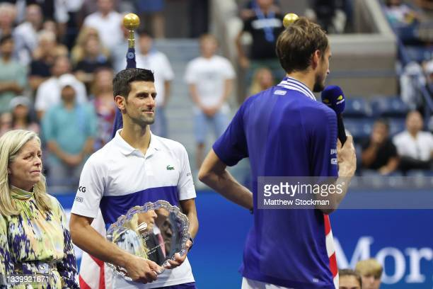 Daniil Medvedev of Russia smiles as he speaks during the trophy ceremony after defeating Novak Djokovic of Serbia to win the Men's Singles final...