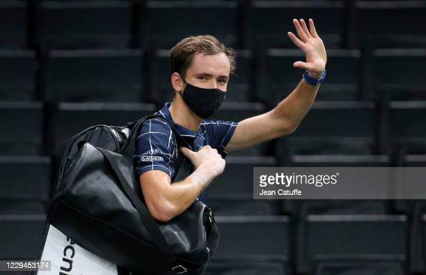 Daniil Medvedev of Russia wears a mask as he celebrates his victory against Kevin Anderson of South Africa, who withdrew from the match due to an...