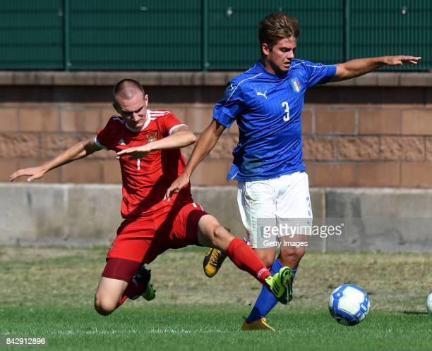 Daniil Utkin of Russia U19 competes for the ball with Alessandro Tripaldelli of Italy U19 during the match between Italy U19 and Russia U19 at Stadio...